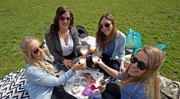 (Clockwise from bottom left) Elle Moore, aged 26, Nikki Slaghekke, 26, Michelle Allen, 27, and Laura Tott, 23, enjoy the warm weather in Hyde Park, London