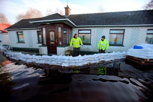 A house in Derrytresk, near Dungannon, under threat from flood water in January