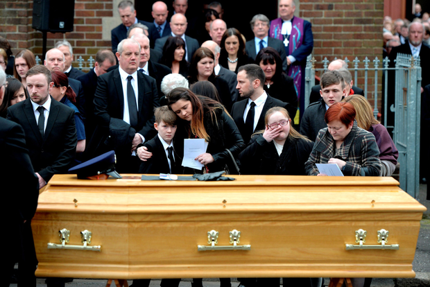 Family at the funeral of prison officer Adrian Ismay, who was injured in a bomb attack
