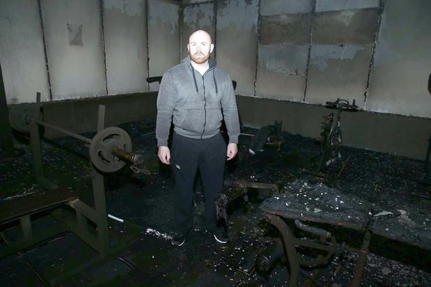 Connell Donnelly inside the gutted interior of his fitness suite at Moy GAA Club