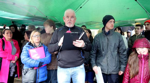 Parents and children protest over ongoing problems at De La Salle College in west Belfast