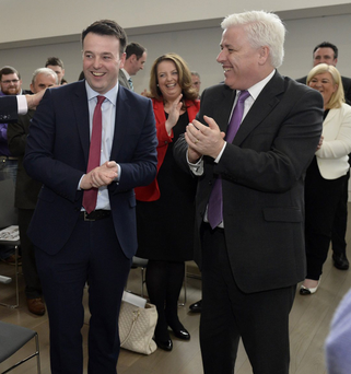 Party leader Colum Eastwood and colleague Fearghal McKinney (right) at the MAC, Belfast, yesterday