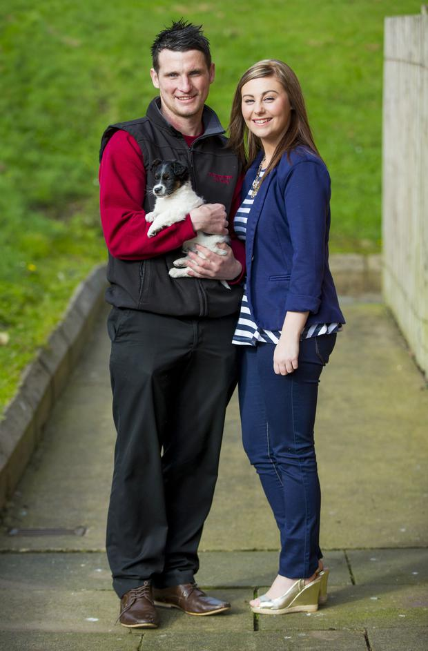 Daniel Grimley and partner Laura Kane with Fluff, pulled from a skip