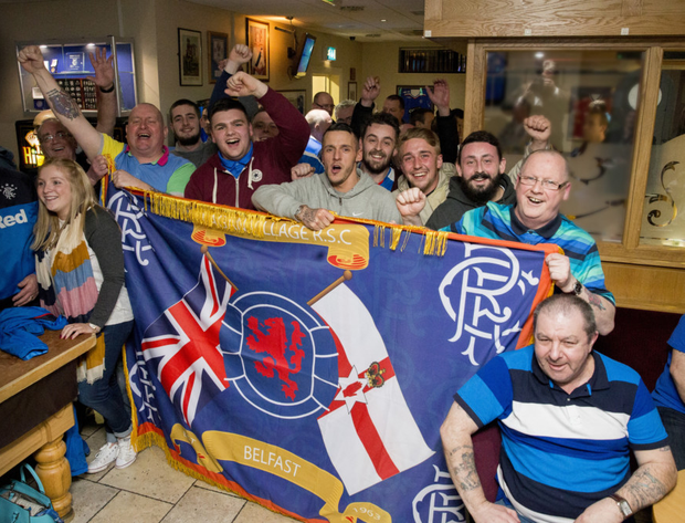 Fans at the Lagan Village Rangers Supporters Club celebrate after James Tavernier's goal secured promotion to Scotland's top tier after a four-year exile
