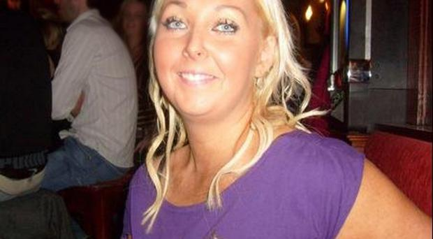 Murdered: 31-year-old Laura Marshall was found by a maintenance man in a block of flats on Victoria Street in Lurgan