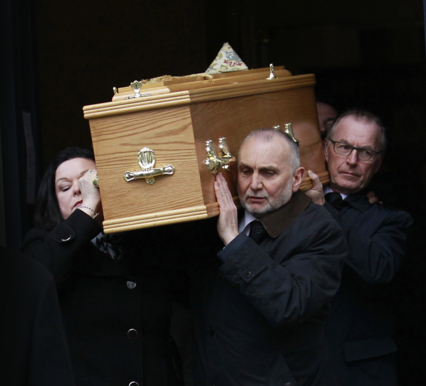 Friends and family carry the coffin of Canon Turner from St George's Church in Belfast's High Street yesterday
