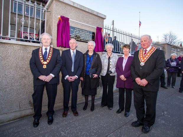 At the dedication of a memorial tablet at Dromore Orange Hall to mark the 40th anniversary of the Herron family atrocity were relatives of the deceased, Alistair Herron (son), Carol Mackey and Joy Bingham (daughters) and Sally Herron (daughter-in-law). Also pictured are the Grand Master of the Grand Orange Lodge of Ireland Edward Stevenson and Sovereign Grand Master of the Royal Black Institution, Millar Farr