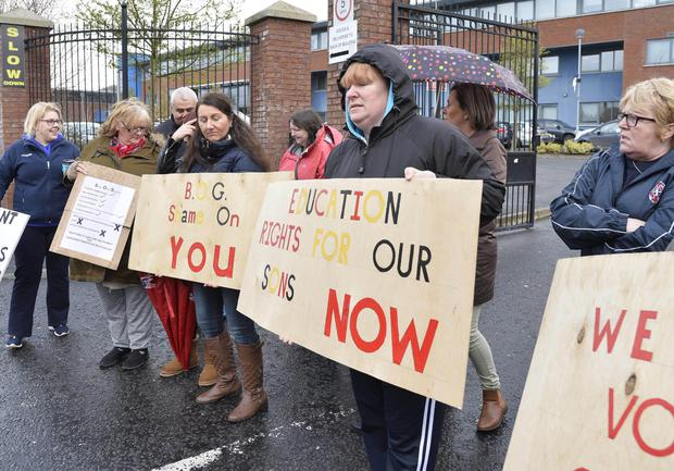 Parents and friends of De La Salle pupils protesting against the ongoing problems at the school