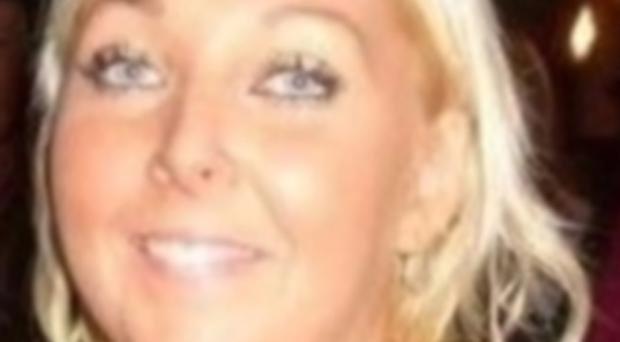 Laura Marshall, 31, was found dead at a flat in Lurgan on Sunday (PSNI/PA)