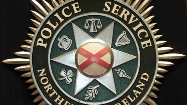 Two men have been arrested after a man was threatened with a suspected firearm in West Belfast.