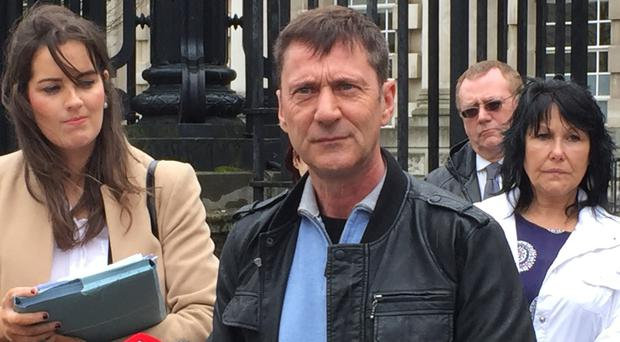 Kincora abuse victim Richard Kerr speaks to the media outside Belfast High Court