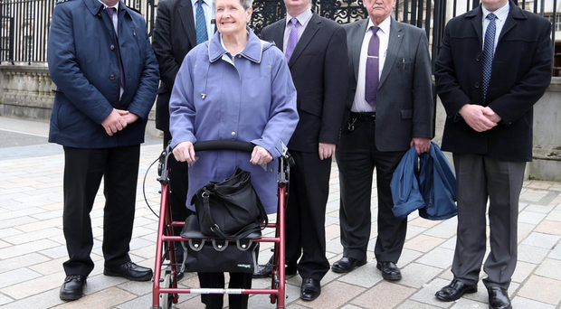 Bea Worton and supporters outside the High Court in Belfast yesterday