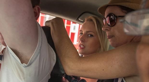 Michaella McCollum and members of her family in the back of a taxi in Lima last week