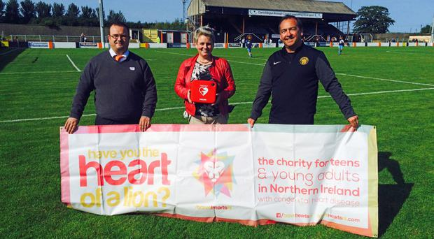 Clare Caulfield with a defibrillator at a local sports club