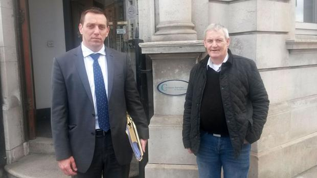 Solicitor Padraig O Muirigh and Jim Rowntree, the brother of Francis Rowntree, at Belfast coroner's court