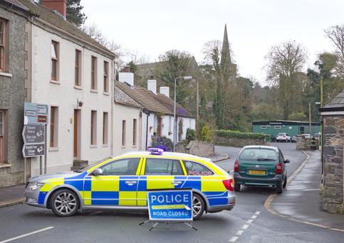 Police at the scene of the two-car crash in Greyabbey yesterday