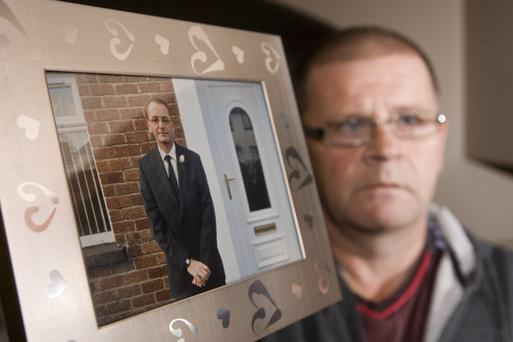 David Lorimer with a picture of his brother Andrew who was beaten to death in 2012