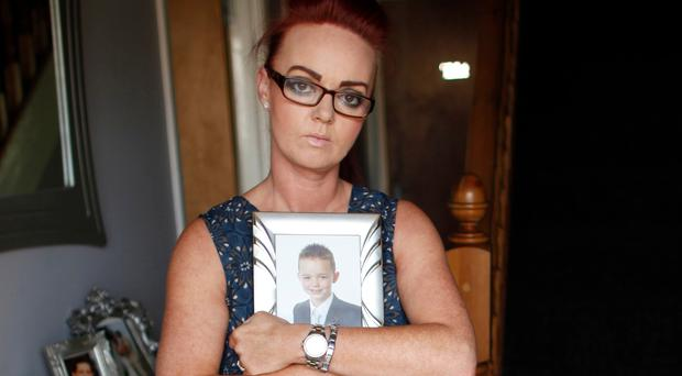 Arlene Shannon with a picture of her son Liam (14) who is currently hospitalised in a psychiatric unit