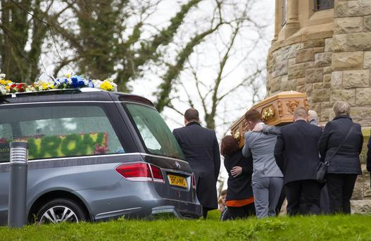 Aaron Fox's coffin is carried by mourners into Holy Cross church