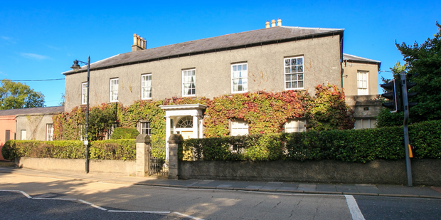 The Manor House in Donaghadee; and (below) a reception room; a gateway to the property's lush gardens and one of the seven bedrooms