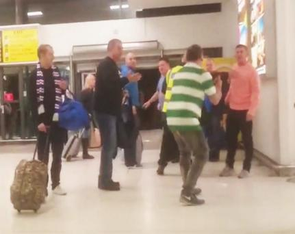 Video showing how the Celtic fan was struck by a man's elbow at George Best Belfast City Airport after Sunday's Old Firm match