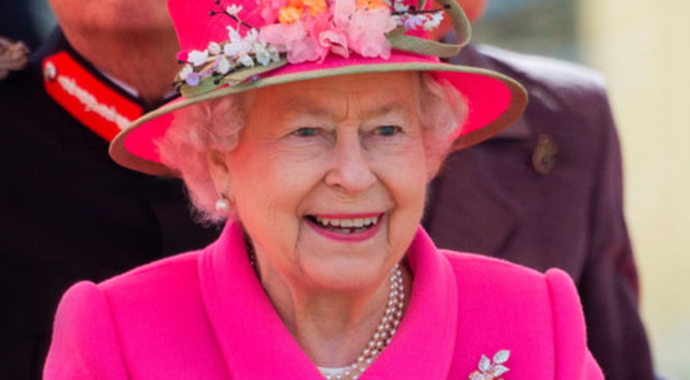 The Queen claps at the opening of a bandstand at Alexandra Gardens in Windsor yesterday