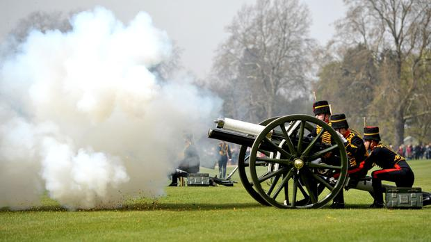 The King's Troop Royal Horse Artillery perform a 41-Gun Royal Salute to mark the Queen's 90th birthday in Hyde Park, central London