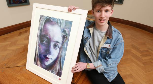 Harry Mathers (15) with his painting entitled Alex
