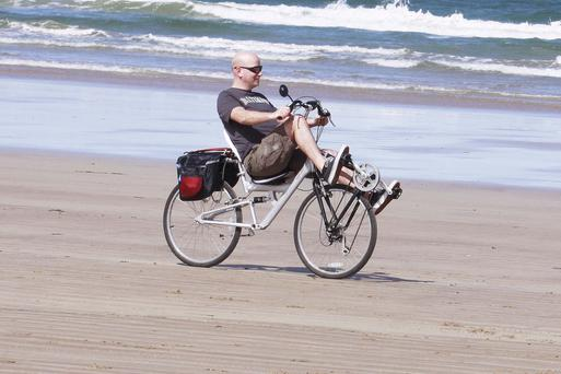 A cyclist takes in the view at Portstewart strand
