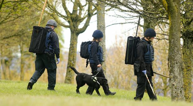 Bomb disposal officers carry out searches of the area yesterday