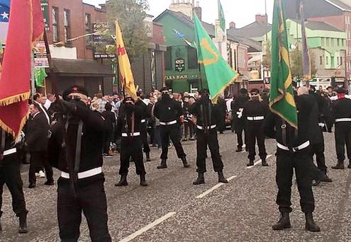 Masked men at the Easter Rising parade in west Belfast