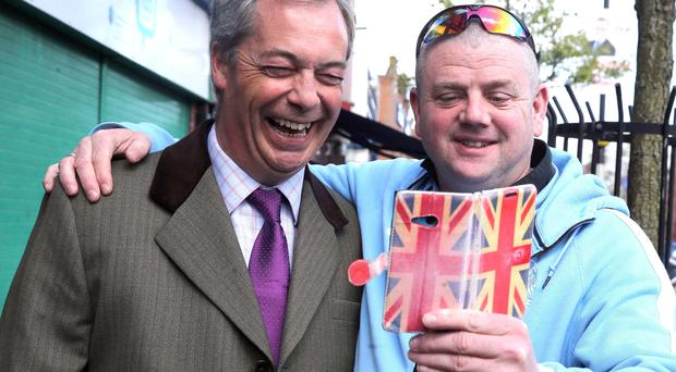 Nigel Farage poses for selfie with passer-by in Sandy Row