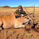 Conservative candidate Roger Lomas with an antelope he shot in South Africa