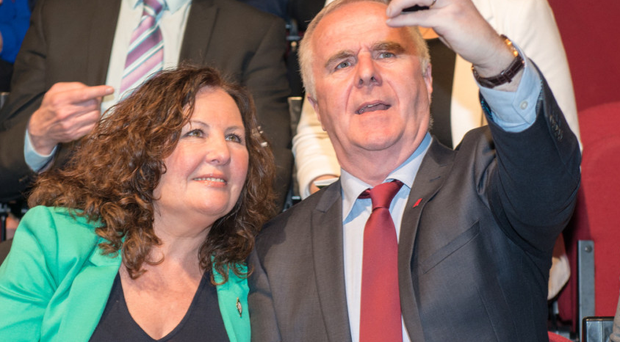 Raymond McCartney takes a selfie during the launch of Sinn Fein's manifesto in Londonderry