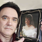 Andy Rodgers with a picture of his late wife Diane