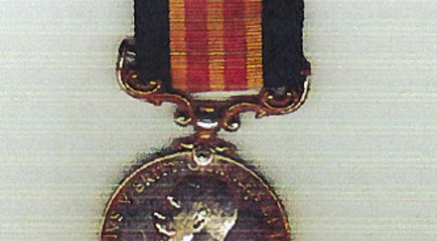 Handed back: One of the medals