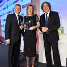 Heather Byrne of the Belfast Telegraph with the award for Weekend Magazine, Alex Evans, managing director of Precision Colour Printing (left) and comedian Alan Davies