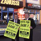 Sam Duff jnr and his father Sam snr outside their old S&R Electrics store on the Holywood Road in east Belfast