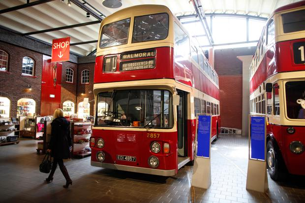 A red bus on display at the Ulster Folk and Transport Museum
