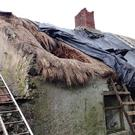 The badly damaged roof of the cottage