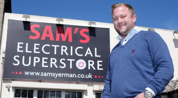 Sam Duff jnr outside his new shop in Newtownards