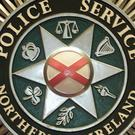 A man was arrested over an armed robbery at a fast food restaurant in Belfast after he was stopped by passers-by