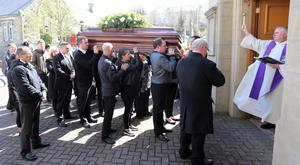 Fr Eamon Graham anoints the coffin of Sister Clare Crockett, who died in the Ecuador earthquake