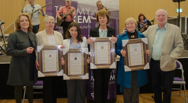 From left: Presenter Marie McStay with scroll of honour recipients at the festival Jeanette Clarke of Armagh (on behalf of her grandmother Rachael Cornett); Edel Murphy, formerly of the Arts Council; Patricia Hagan of Keady (on behalf of her grandfather James Green); Gertie O Reilly (daughter of Keady poet Peter Connolly), and Peter Makem of the festival