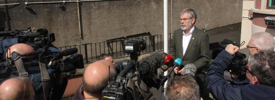 Gerry Adams is left to face his media inquisitors alone outside Sinn Fein's headquarters in west Belfast yesterday in the wake of his n-word tweet furore