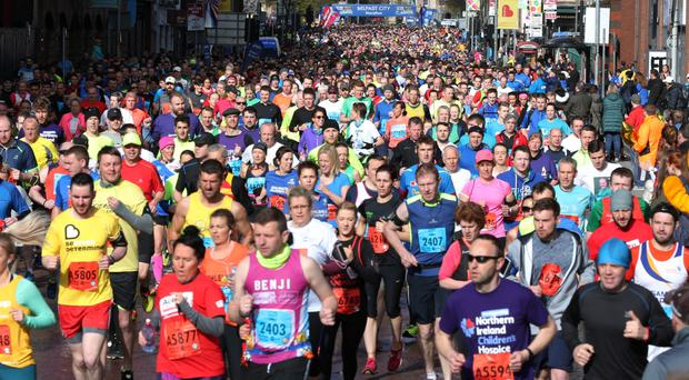 Runners make their way through the city centre