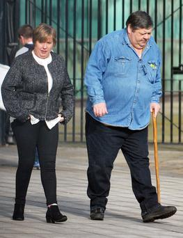 Benefits fraudsters Michael Rennick and his wife Brenda Rennick at Belfast Crown Court yesterday