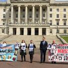 Families of those killed by the British Army in Ballymurphy in 1971 protest outside Parliament Buildings in Stormont