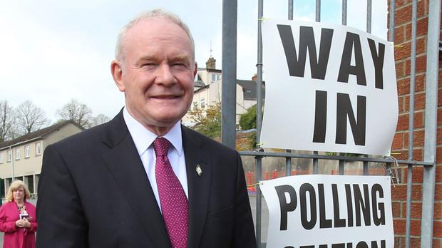 Sinn Fein's Martin McGuinness arrives at a polling station at Model Primary School in Londonderry