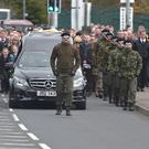 The funeral cortege of Michael Barr on its way to St Mary's Church in the Melmount area of Strabane (Strabane Chronicle/PA)